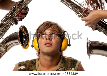 The young man in ear-phones and two saxophones. Loud noise. - stock photo