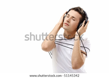 The young man in ear-phones on a white background - stock photo