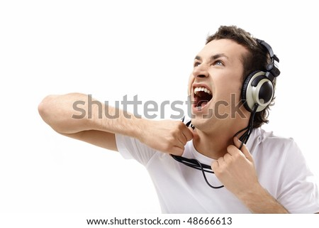 The young man in ear-phones shouts on a white background - stock photo