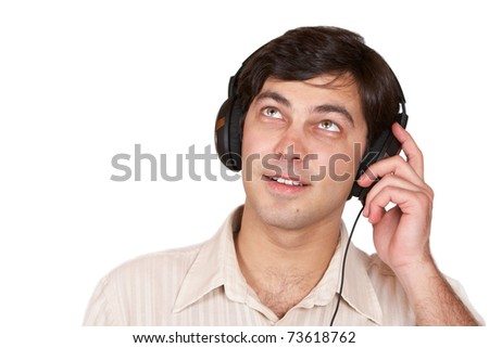 The young man listens to music on headphones