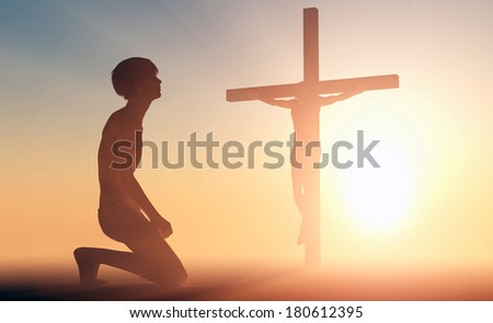 The young man praying before a crucifix. - stock photo