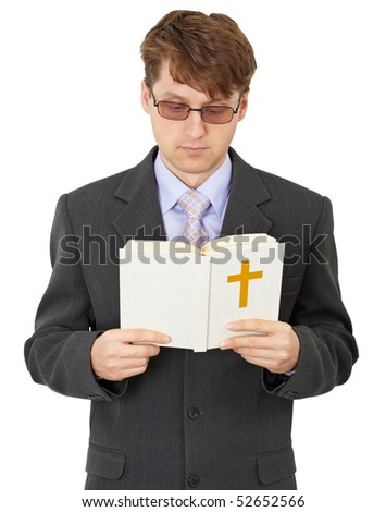 The young man read the Bible carefully - stock photo