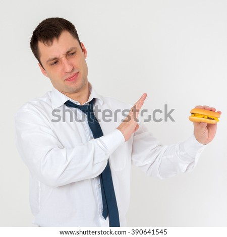 the young man refuses a tasty burger