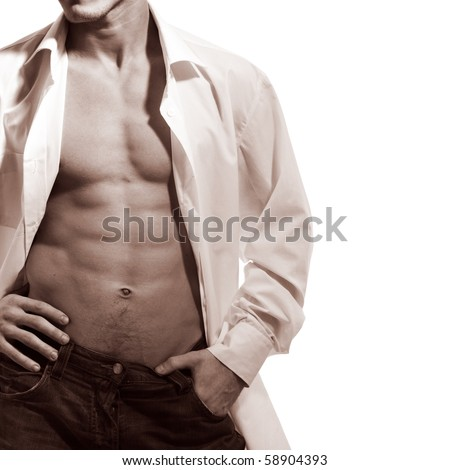 The young man shows beautiful body - stock photo