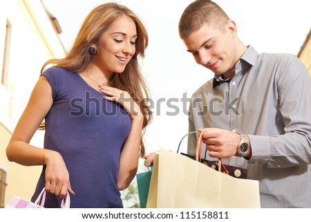 The young man shows what he bought - stock photo
