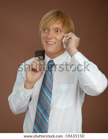 The young man talks by a mobile phone - stock photo