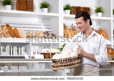 The young man with a basket of cakes - stock photo