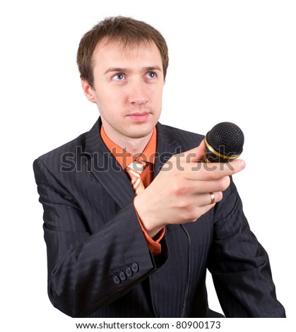 The young man with a microphone interviews - stock photo