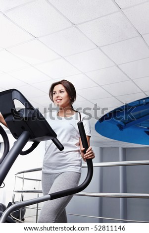 The young nice girl on a racetrack - stock photo
