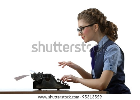 The young nice girl works on typewriter - stock photo