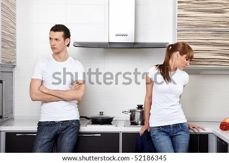 The young quarrelled couple on kitchen - stock photo