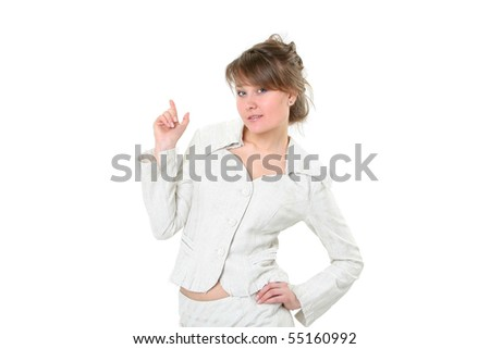 The young smiling business woman who is pointing a finger on copyspace on a white background