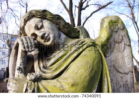 The young stone Woman in the Winter from the old Prague Cemetery - stock photo