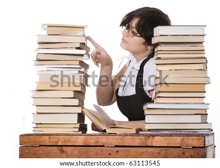 The young student girl with the books isolated on a white background