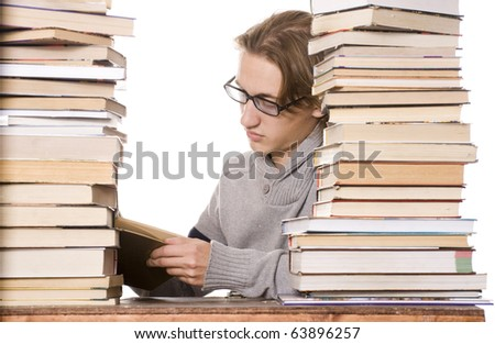 The young student with the books isolated on a white background