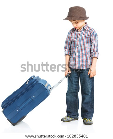 The young traveler boy with a suitcase. Isolated over white background - stock photo