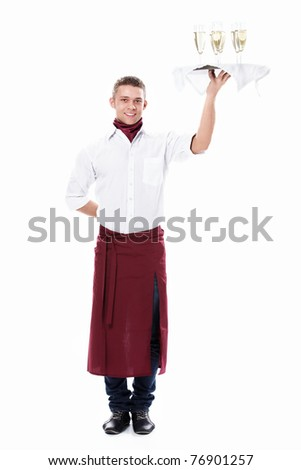 The young waiter with a tray with glasses of champagne on a white background - stock photo