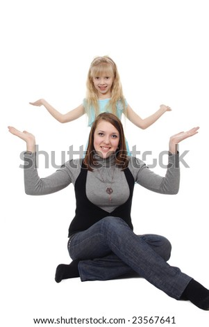 The young woman and the girl pose in an identical pose - stock photo