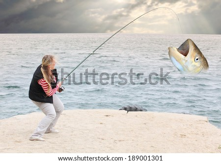 The Young Woman and the Sea. Funny picture from fishing. - stock photo