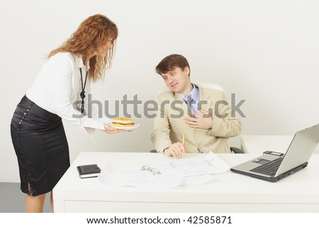The young woman delivered to the chief a sandwich to a dinner (studio shot) - stock photo