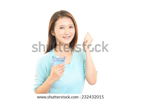 The young woman drinking a glass of water
