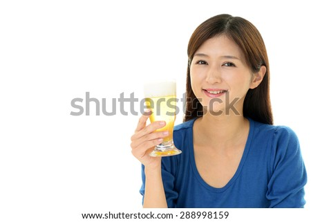 The young woman drinking beer