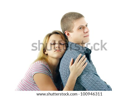 The young woman gently embraces the beloved - stock photo