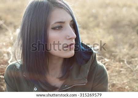 The young woman girl with blue hair. Autumn portrait