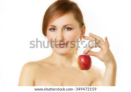 the young woman holds apple in hand