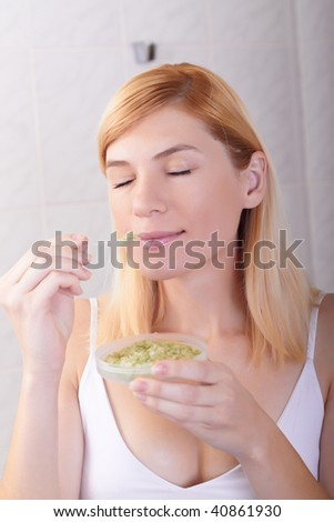 The young woman holds aromatic means - stock photo
