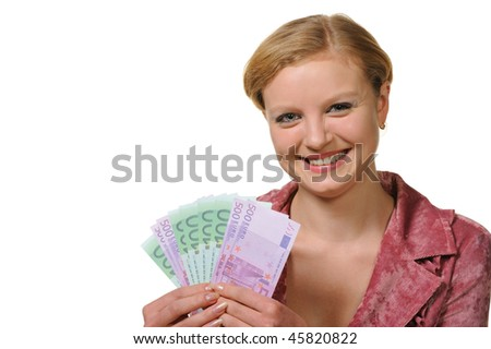 The young woman holds the European currency in hands. It is isolated on a white background