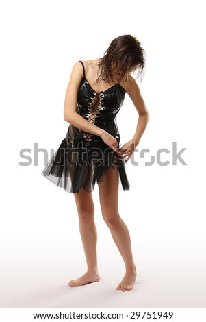 The young woman in a short black leather dress - stock photo