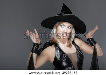 The young woman in a suit of a witch
