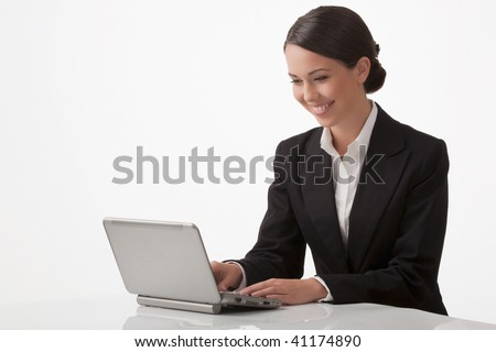 The young woman joyfully with pleasure works on a computer - stock photo