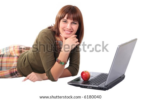 The young woman laying with laptop, isolated on white