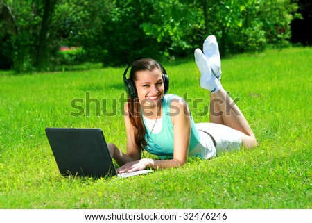The young woman listens to music in headphones