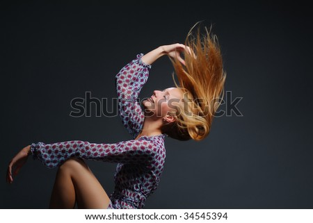 The young woman on a dark background - stock photo