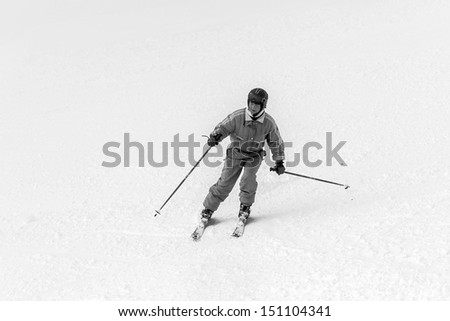 The young woman on a mountain-skiing slope of the resort of Mayrhofen - Austria (black and white) - stock photo