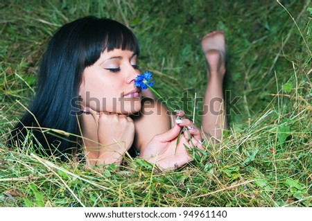 The young woman relaxing on hayloft