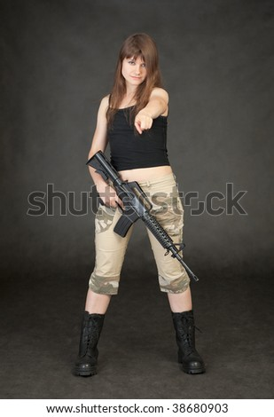 The young woman with a rifle in a hand shows on us