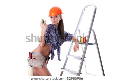 The young woman with paints on a white background. The house painter - stock photo