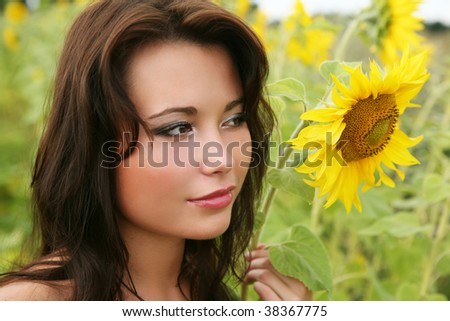 The young woman with sunflowers.
