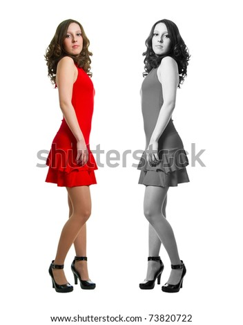 The young women in red dress on a white background. Isolation - stock photo