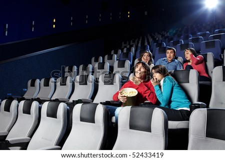 The youth looks a film at a cinema - stock photo