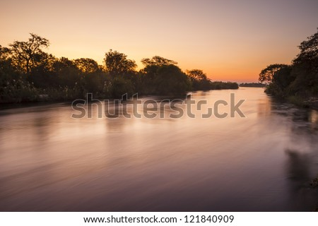 The Zambezi River at dusk, seen from Zambia - stock photo