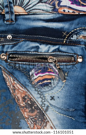 The zipper on the pocket of women's jeans - stock photo