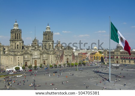 the zocalo in mexico city, with the cathedral and giant flag in the centre - stock photo