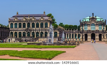 The Zwinger (Der Dresdner Zwinger), a palace in Dresden, eastern Germany, built in Rococo style. - stock photo
