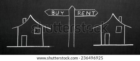 Thearrow with choose buy or rent written on the blackboard with chalk - stock photo