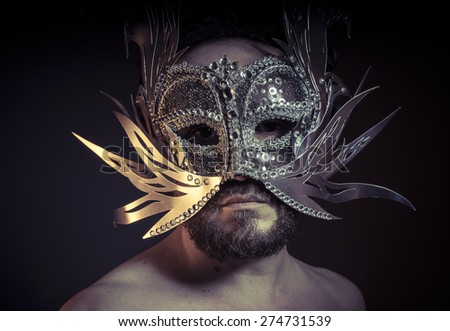 Theater, bearded man with silver mask Venetian style. Mystery and renaissance - stock photo